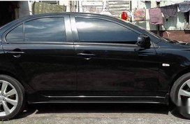 Black Mitsubishi Lancer Ex 2014 at 76000 km for sale