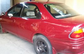 Red Mazda 323 1999 at 100000 km for sale