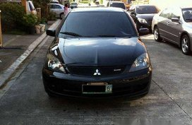 Sell Black 2009 Mitsubishi Lancer in Quezon City