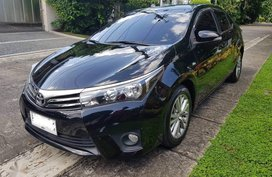 Selling Black Toyota Corolla altis 2015 in Quezon City