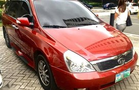 Red Kia Carnival 2012 for sale in Manila
