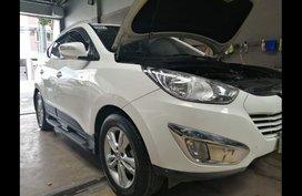 Selling White Hyundai Tucson 2012 in Malolos