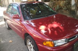 Selling Red Mitsubishi Lancer 1996 in Quezon City
