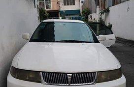 Sell White 2001 Mitsubishi Lancer in Quezon City