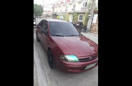 Sell Red 2001 Ford Lynx Sedan in Mabalacat