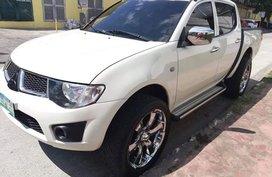 White Mitsubishi Strada 2012 Truck for sale in Manila