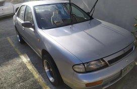 Silver Nissan Almera for sale in Manila