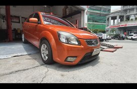 Selling Orange Kia Rio 2010 Sedan in Manila