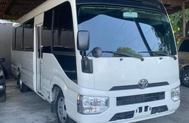 White Toyota Coaster for sale in Manila