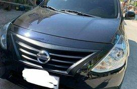 Selling Black Nissan Almera 1.5 Auto