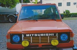 Selling Orange Mitsubishi Pajero for sale in Bustos