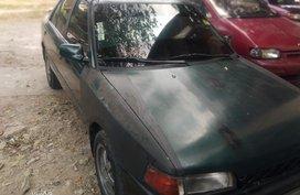 Sell Black Mazda 323 for sale in Valenzuela