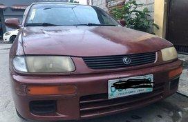 Sell Purple Mazda Familia in Caloocan