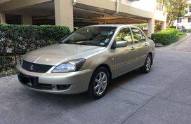 Selling Beige Mitsubishi Lancer for sale in Manila
