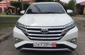 Selling White Toyota Rush for sale in Manila