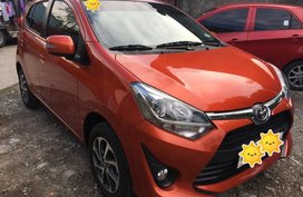 Selling Orange Toyota Wigo in Dasmariñas
