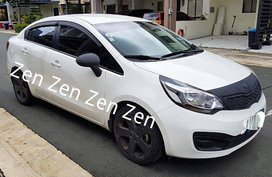 Sell White Kia Rio in Quezon City
