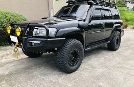 Black Nissan Patrol super safari 2010 for sale in Manila