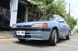 Selling Blue Mazda 323 in Las Piñas