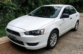 Selling White Mitsubishi Lancer ex in Taguig