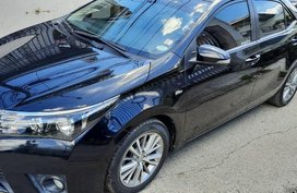 Sell Black 2014 Toyota Corolla in Bauan
