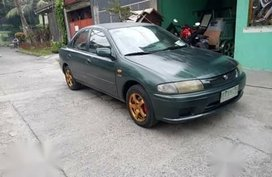 Green Mazda 323 for sale in Bulacan