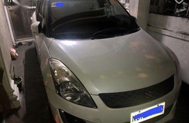 Selling Pearl White Suzuki Swift in Quezon City