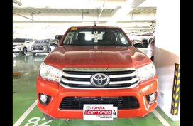 Orange Toyota Hilux 2018 at 27364 km for sale in Manila