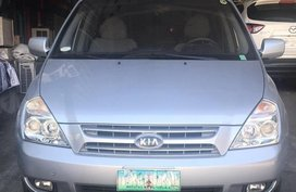 Silver Kia Carnival for sale in Pasig