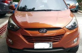 Sell Orange Hyundai Tucson in Manila