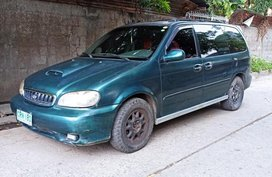 Blue Kia Carnival for sale in Las Piñas