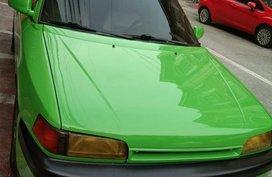 Green Mazda Familia for sale in Manila