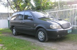 Sell Black Kia Carnival in Iligan