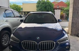 Selling Blue Bmw X1 in Parañaque
