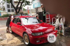 Red Mazda 323 1996 for sale in Quezon City
