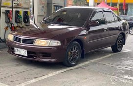 Red Mitsubishi Lancer 2000 Sedan at 113000 km for sale in Manila