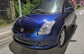 Selling Blue Suzuki Swift 2009 in Lipa