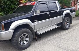 Selling Black Mitsubishi Strada 1995 in Davao