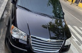Selling Black Chrysler Town And Country 2010 in Pasig