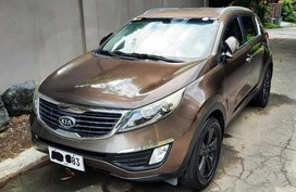 Brown Kia Sportage 2012 for sale in Manila