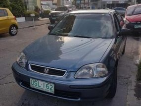 Honda Civic LXi 1997 and Toyota REVO GLX 2003