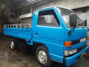 ISUZU NKR 4BE1 4W dropside 10ft Metal Flr