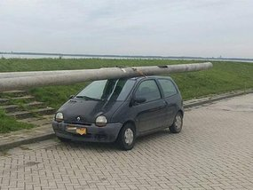 A man arrested for driving with two stolen lamp posts on the roof of his Renault