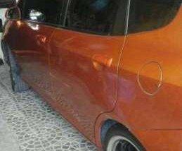 Honda fit 2003 hatchback orange for sale