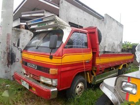 Isuzu Elf 4BC1 14ft Dropside Red Truck For Sale