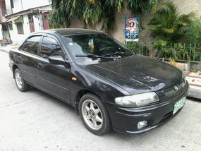 Good as new Mazda 323 1999 for sale