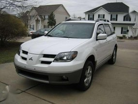 Looking for 2004-2005 Mitsubishi Outlander AT