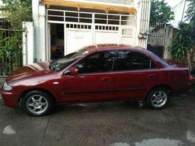 Selling lady driveN Mazda Familia 323 1996