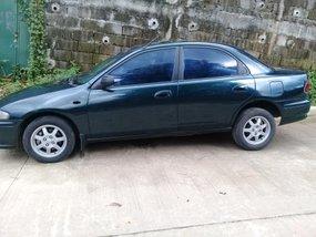 Mazda 323 1999 Model Green For Sale