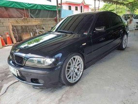 Selling Black Bmw 318I 2003 at 100000 km